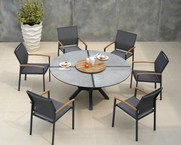 Runder grosser Gartentisch HPL Teakholz drehplatte mit 6 Alex Stapelstühlen auf Terrasse - bowi.ch